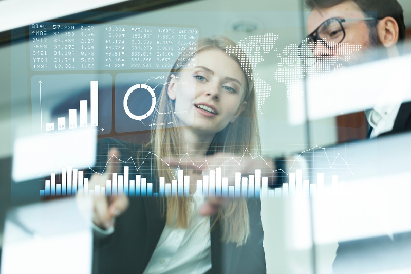 young female business professional looking at the data